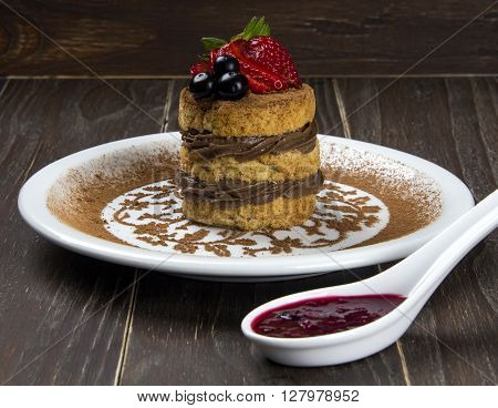 Tiramisu - Classical Dessert With Cinnamon And Coffee. Garnished With Strawberry.
