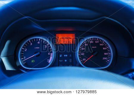 tachometer of a modern car blur focus evening light