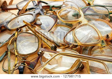 Heap of old used glasses as a background