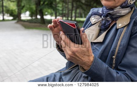 Closeup of elderly female hands holding mobile phone