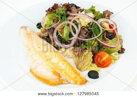 Roasted whitefish fillet with mixed fresh salad isolated on white background