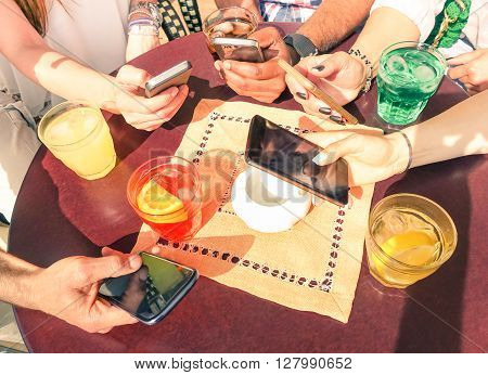Close up of multiracial friends group in disinterest moment with mobile smart phone - Relationship apathy concept and addiction using smartphones - People hands having fun on social media networking
