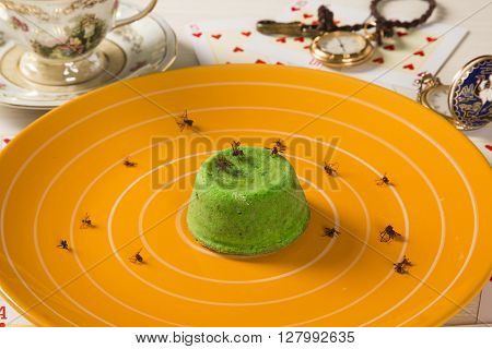 Petit gateau with green sava ant. Gourmet dessert.