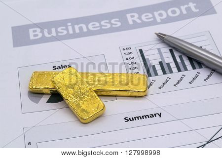 Gold Bullion on business report Financial accounting Selective focus.