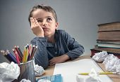 Thinking child bored, frustrated and fed up doing his homework poster