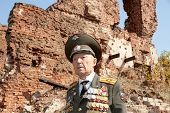Defender of Stalingrad veteran of World War II colonel Vladimir Semenovich Turov against Stalingrad military ruins poster