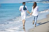 happy young couple in white clothing have romantic recreation and fun at beautiful beach on vacations poster