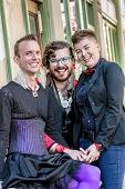 Grinning gender fluid trio of young friends poster