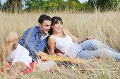 happy young couple enjoying picnic on the countryside in the field and have good time poster
