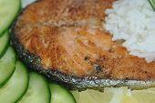 fragment fried salmon with vegetables and rice poster