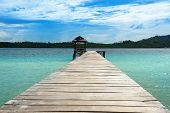 Wooden Dock on Togean Islands or Togian Islands in the Gulf of Tomini. Central Sulawesi. Indonesia poster