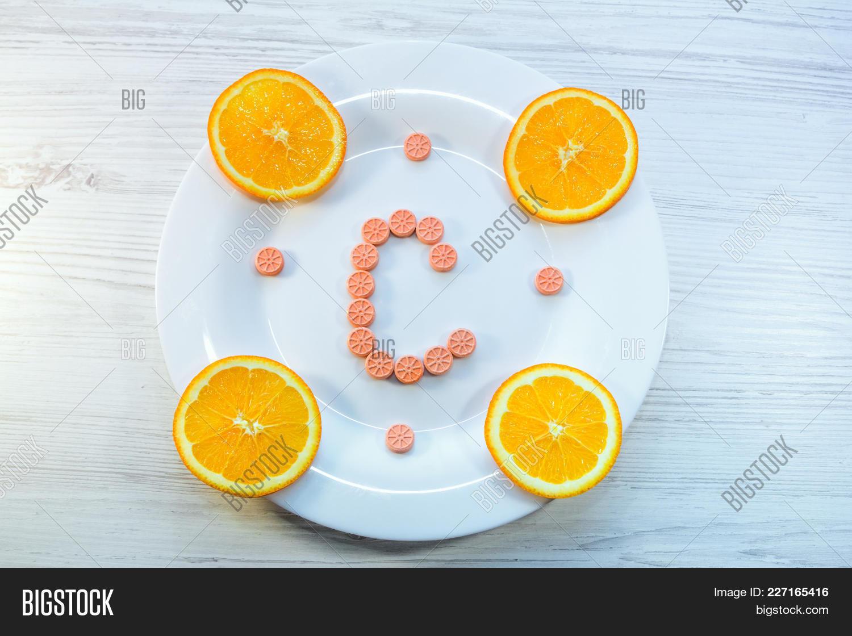 Vitamin c concept powerpoint background powerpoint template p toneelgroepblik Images