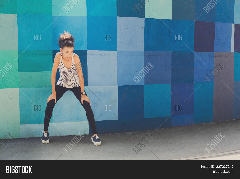 Woman pensive african american standing powerpoint template woman y toneelgroepblik Gallery