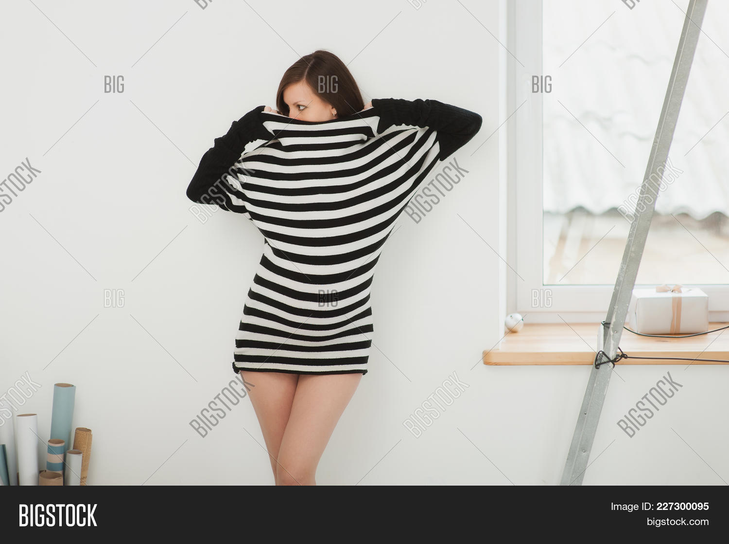 04f1d9a77ca06 Beautiful Fashion Pregnant Young Happy Brunette Woman In Striped Black White  Dress With Big Belly,