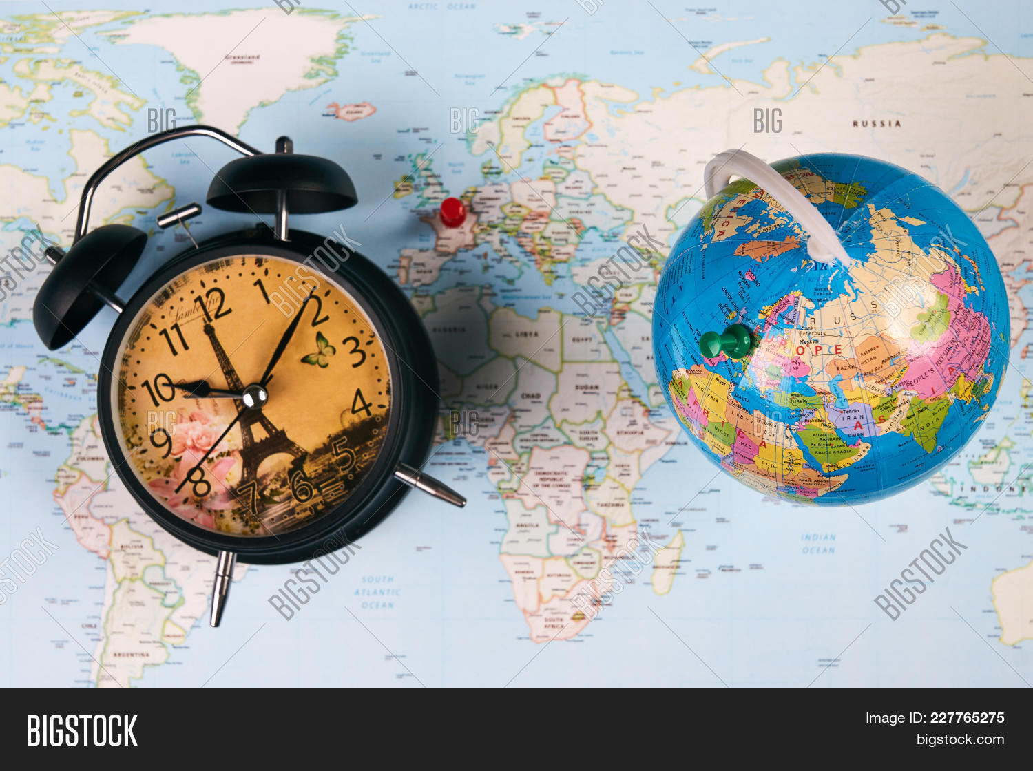 Planing travel france paris image photo bigstock planing for travel to france paris with worldmap globe and alarm clock travel time in gumiabroncs Image collections