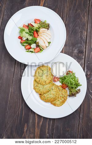 potato pancakes and salad