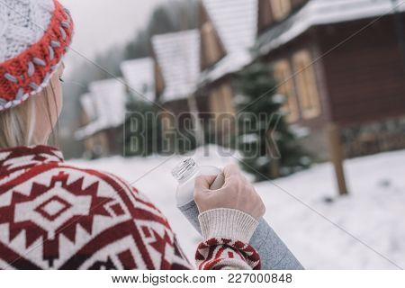Woman with thermos outdoor