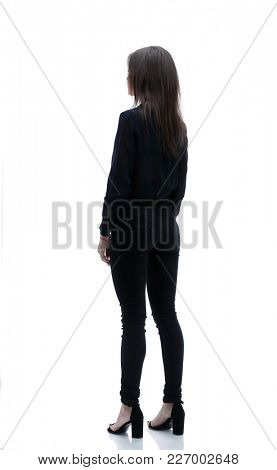 back view . Confident business woman looking forward. Photo in full growth.