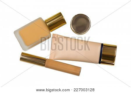 Packages of cosmetic makeup, bottle of liquid foundation, long wear lightweight, flawless wear creamy concealer and skin care product isolated on white background