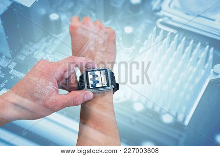 Cropped image of man using watch against micro parts of mother board