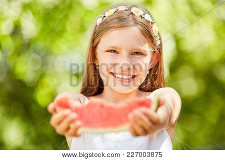 Helpful girl wants to give something of her watermelon