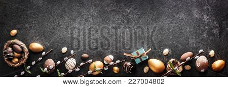 Easter Decoration With Golden Eggs on Dark Shale Background