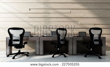 Three chairs standing at empty workstation desks in office room. 3d Rendering.