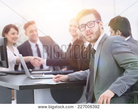 handshake business partners with the Manager in the foreground