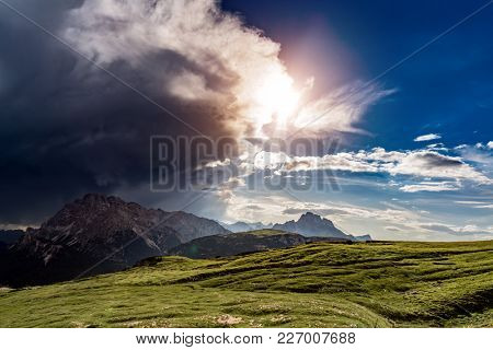 A storm cloud is coming in the sun. The beginning of the storm. National Nature Park Tre Cime In the Dolomites Alps. Beautiful nature of Italy.
