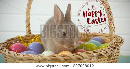 Happy Easter red logo against a white background against colorful easter eggs and easter bunny in wicker basket