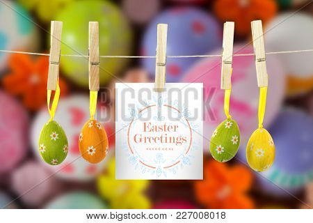 Easter greeting against painted easter eggs with different designs