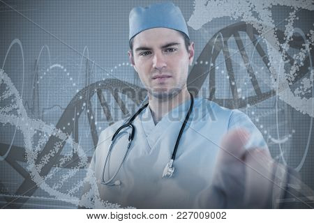 Surgeon pretending to be using futuristic digital screen against red spiral dna pattern