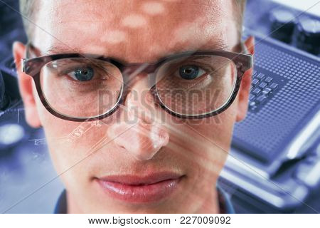 Close up portrait of man wearing eyesglasses against human brain in circuit board