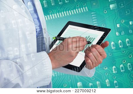 Midsection of female doctor using digital tablet with stylus against green and black electronic circuit
