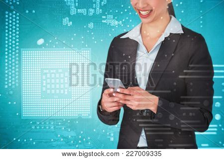 Smiling businesswoman holding mobile phone against micro parts in computer chip