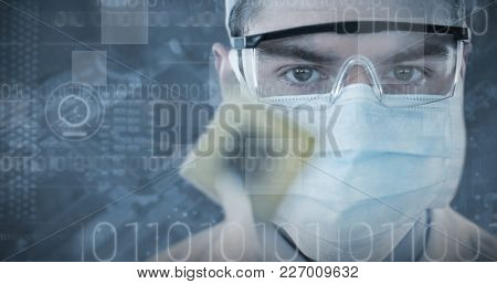 Doctor in protective glasses and surgical mask holding electronic chip against electronic circuit board