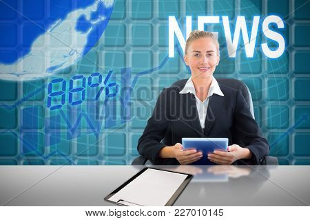 Businesswoman sitting on swivel chair with tablet against blue