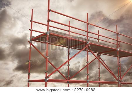 Digitally generated image of scaffolding against blue sky with white clouds