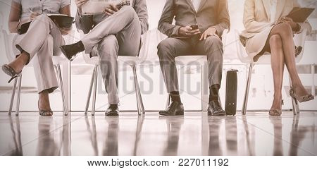 Low section of business people waiting in office