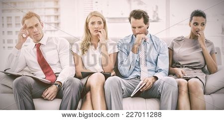 Nervous business people waiting for job interview