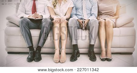 Portrait of executives waiting for job interview in office