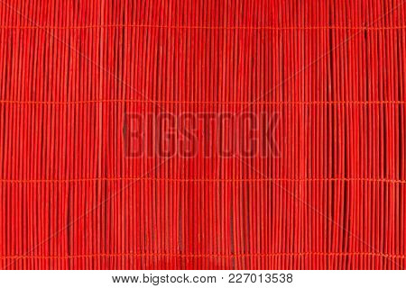 Red Sticks In Dark Background. Red Sticks Tied Up Between Each Other With The Rope