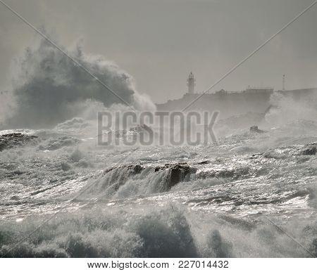 Rough Sea On The Coast, Big Waves And Lighthouse, La Garita, Gran Canaria, Canary Islands