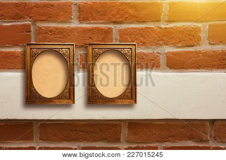 Gilded Wooden Frames For Pictures On Old Brick Wall