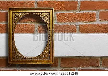 Gilded Wooden Frame For Pictures On Old Brick  Wall