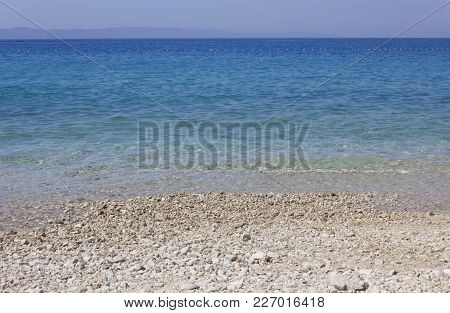 Tucepi, Croatia - August 13 2017: Stobrec Beach With Its White Pebbles And Crystalline Beach