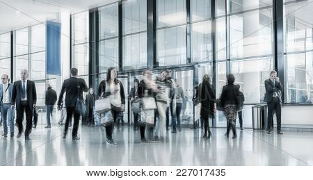 Blurred People Rushing At A Entrance On A Airport, Including Copy Space Banner. Ideal For Websites A