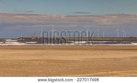 Wind Turbines At The North Sea Coast Of The North Gare Beach In Seaton Carew, Hartlepool, Uk