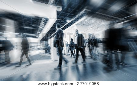 Blurred Business People Rushing On A Hall At A Trade Fair. Ideal For Websites And Magazines Layouts