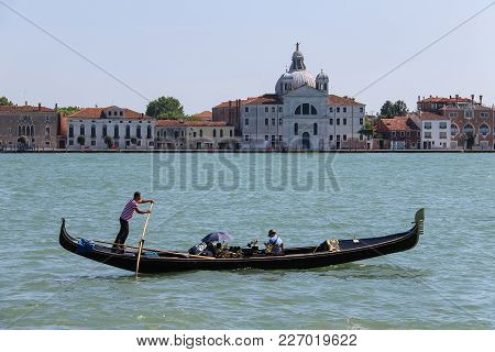 Venice, Italy - August 13, 2016: Gondola With Tourists In Grand Canal